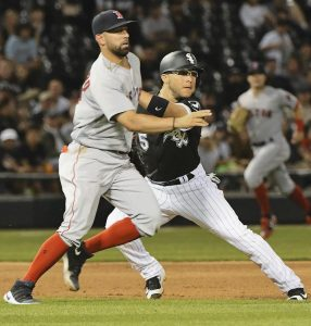 CHICAGO WHITE SOX BASE RUNNER Yolmer Sanchez (5) and Boston Red Sox third baseman Deven Marrero watch the ball before Sanchez was tagged out during the fifth inning of a baseball game in Chicago on Wednesday. The Red Sox won, 4-1.