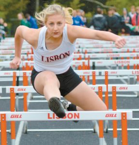 LISBON HIGH SCHOOL senior Chase Collier leaps over a hurdle during the 100-meter hurdle race at the Mountain Valley Conference Track and Field Championships in Lisbon last week. Collier will be looking for her first state title on Saturday at Foxcroft Academy, where the Class C Championships will be held, beginning at 10 a.m.