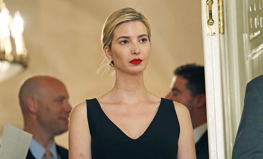 Ivanka Trump, the daughter and assistant to President Trump, stands in the doorway as her father speaks before signing bills in the Diplomatic Reception Room at the White House, in Washington.