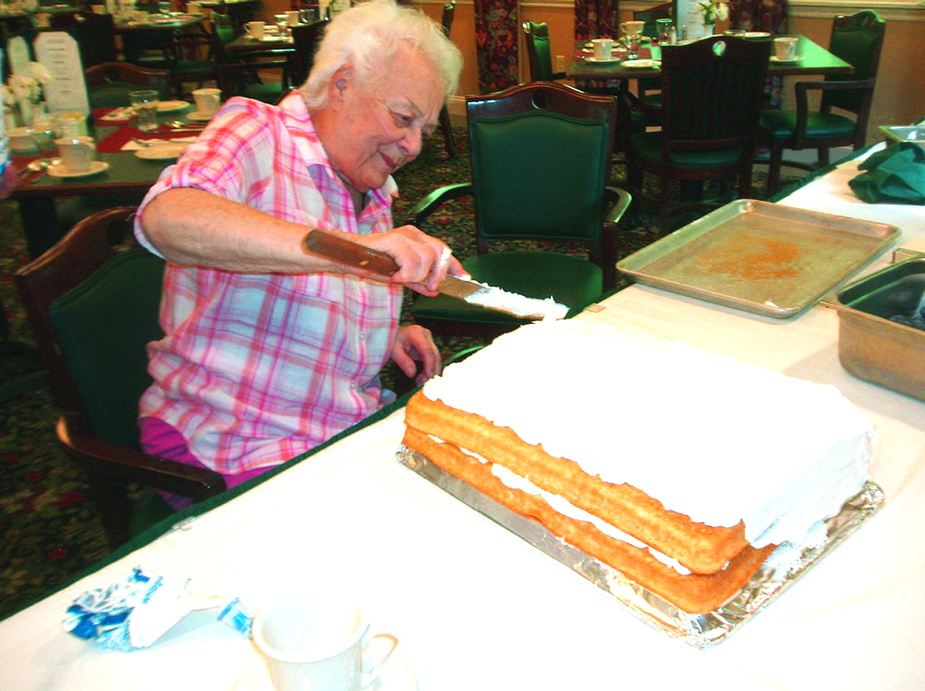 Atria Kennebunk resident Irene LeClerc works on a cake for residents on Flag Day. SUBMITTED PHOTO