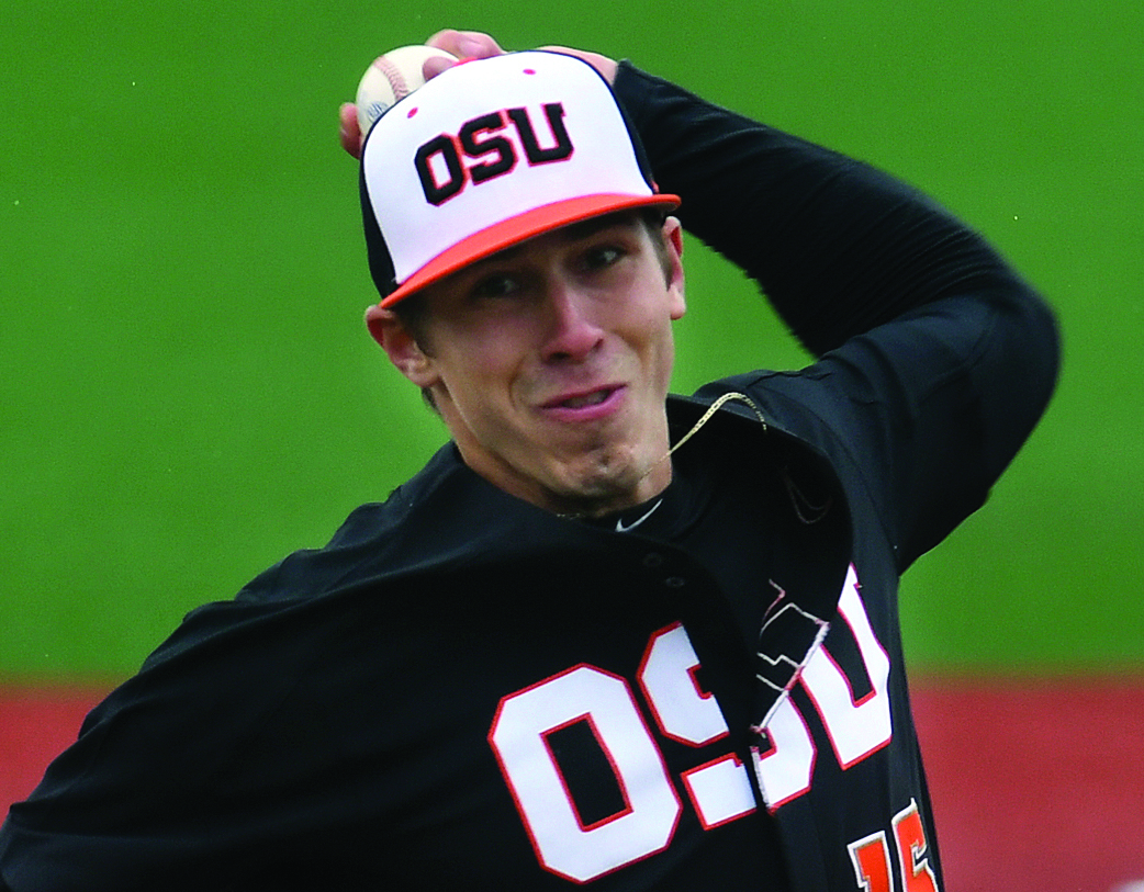 In this March 4, 2017, file photo, Oregon State pitcher Luke Heimlich throws during an NCAA college baseball game against UC Davis in Corvallis, Ore. Heimlich, who as a teenager pleaded guilty to molesting a 6-year-old girl, will not accompany the Beavers to the College World Series. AP NEWSWIRE