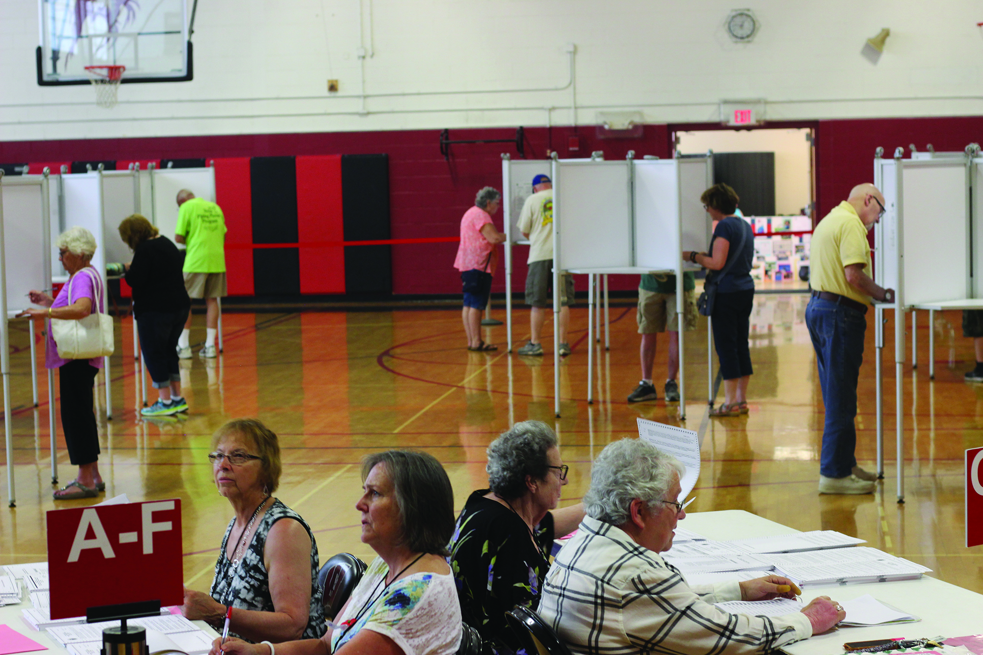 Wells residents mark down their votes in voting booths at the Wells Junior High School gymnasium on Tuesday afternoon. The town ballot carried significant questions this year, such as a multimillion dollar bond question over the creation of new public safety complexes. RYDER SCHUMACHER/Journal Tribune