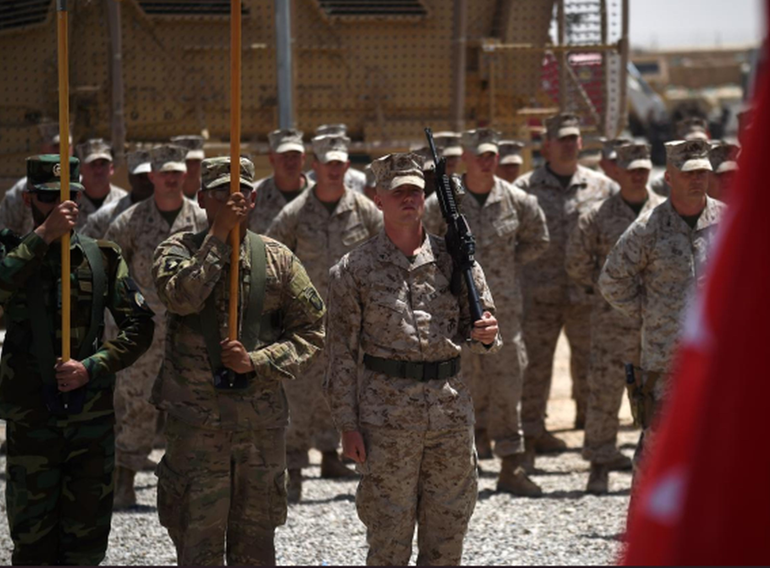 U.S. Marines and Afghan National Army soldiers at a handover ceremony at Leatherneck Camp in Afghanistan's Helmand Province on April 29. AP WIREPHOTO