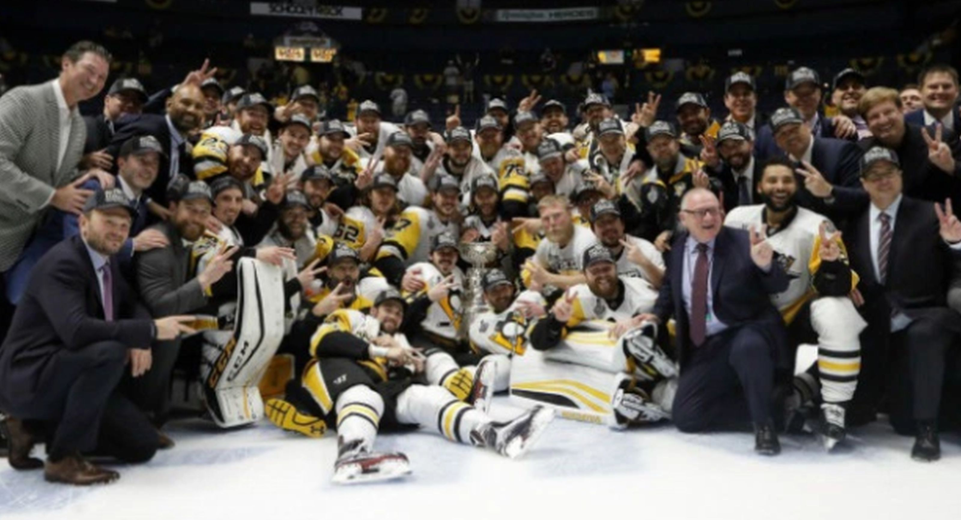 Pittsburgh Penguins players and coaches celebrate after defeating the Nashville Predators 2-0 in Game 6 of the NHL hockey Stanley Cup Final, Sunday, June 11, 2017, in Nashville, Tenn. AP WIREPHOTO/Mark Humphrey