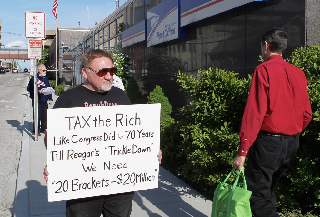 James Hodgkinson protests outside a post office in Belleville, Ill., in April 2012.