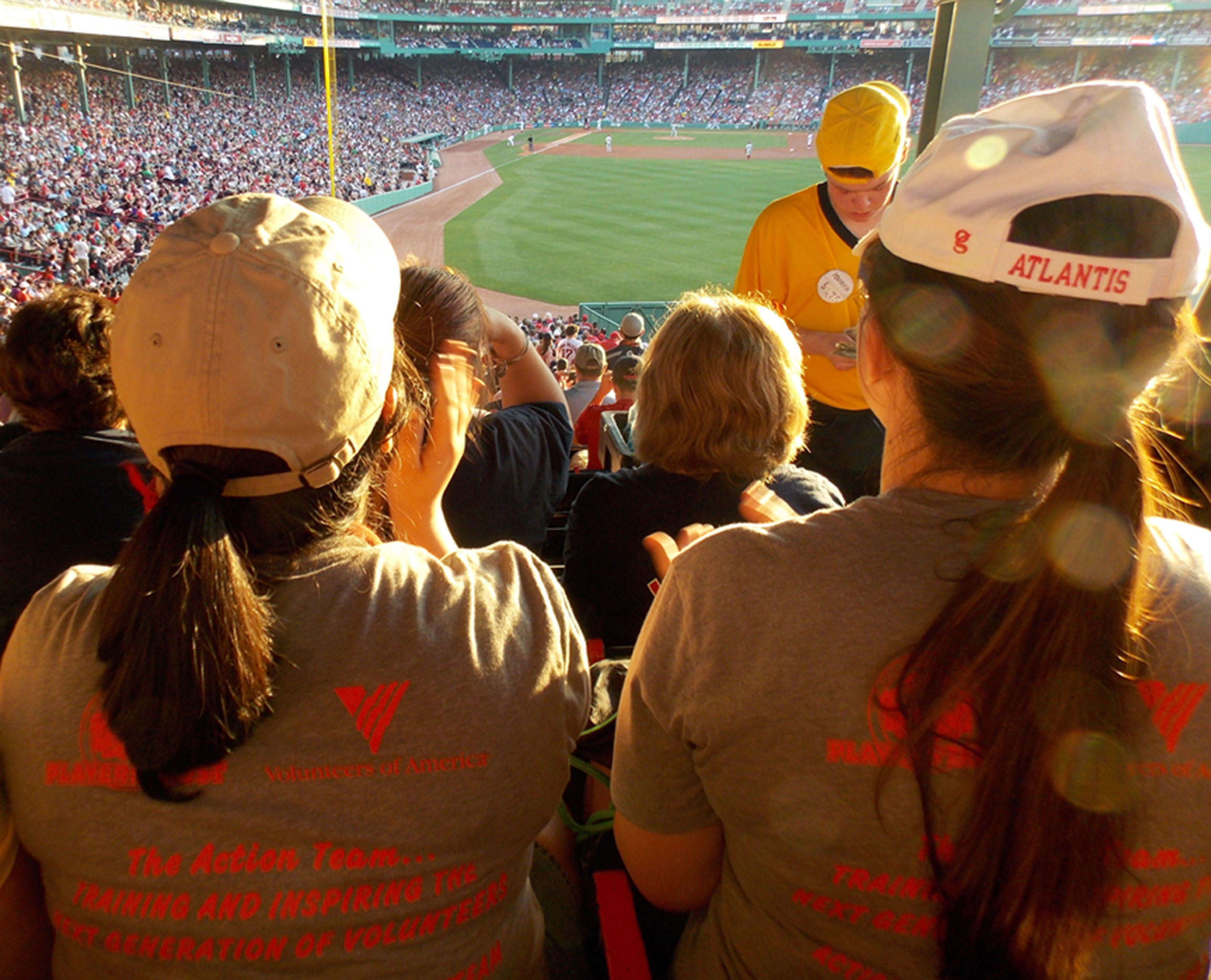 Annie Karim and Elizabeth Roy of the Thornton Academy Action Team cheer on the Red Sox. LINDSEY HALL/ Journal Tribune