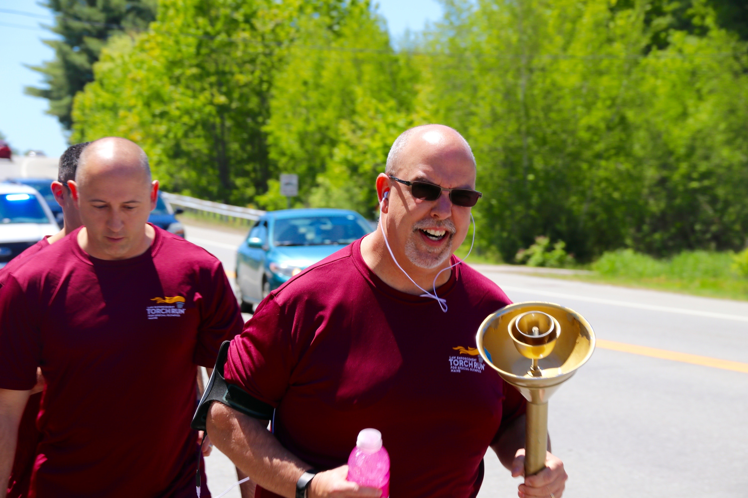 Biddeford Police Department dispatcher R.J. Legere carries the torch for Biddeford in the Special Olympics Torch run on Wednesday.TAMMY WELLS/Journal Tribune