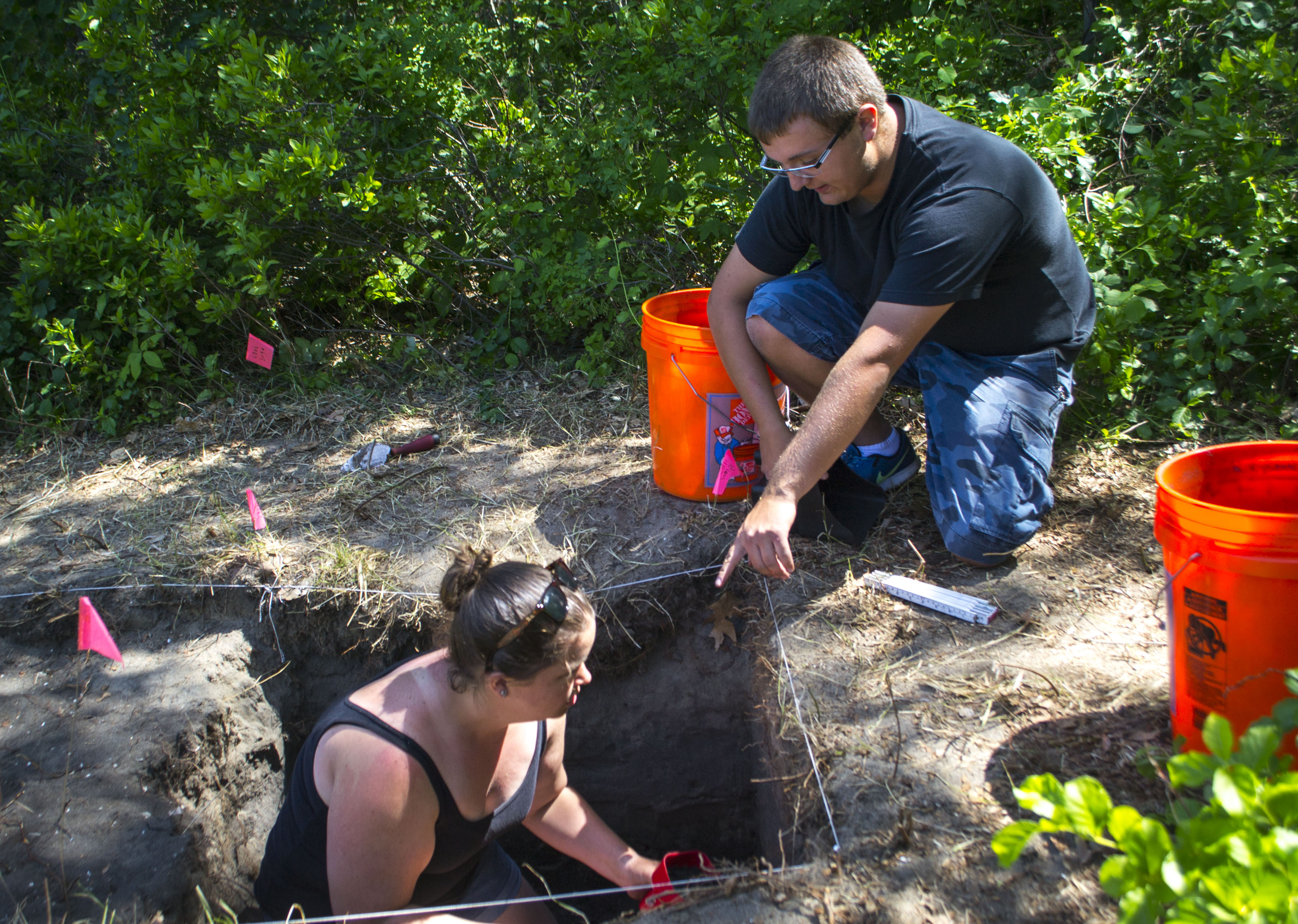 Mary Hollandbeck and Kyle Brennan excavate a plot of land as part of their archaeological field methods course at the University of New England on Wednesday. ALAN BENNETT/Journal Tribune