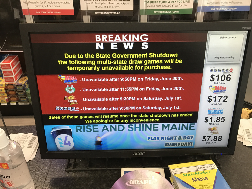 A sign at Joe's Super Variety on Congress Street in Portland informs customers that lottery tickets are unavailable on Saturday, July 1, 2017.