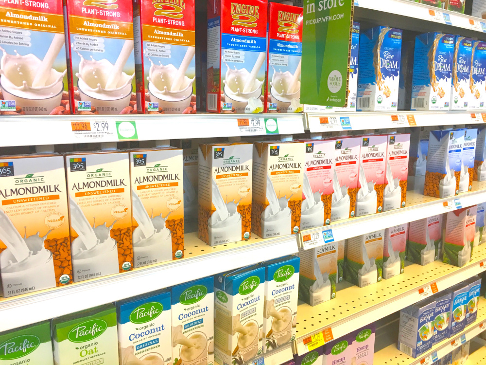 """The word """"milk"""" appears on many plant-based beverages at the Portland Whole Foods Market."""