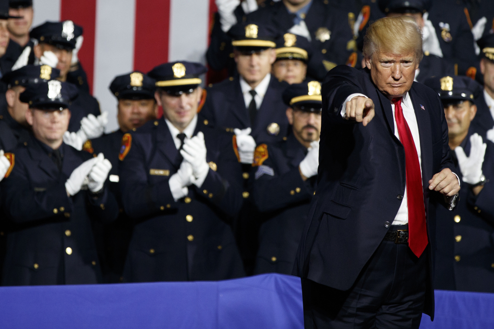 "President Trump engages with a crowd of law enforcement officials Friday in Brentwood, N.Y.: ""When you guys put somebody in the car and you're protecting their head,"" he told them, ""... you can take the hand away, OK?"""