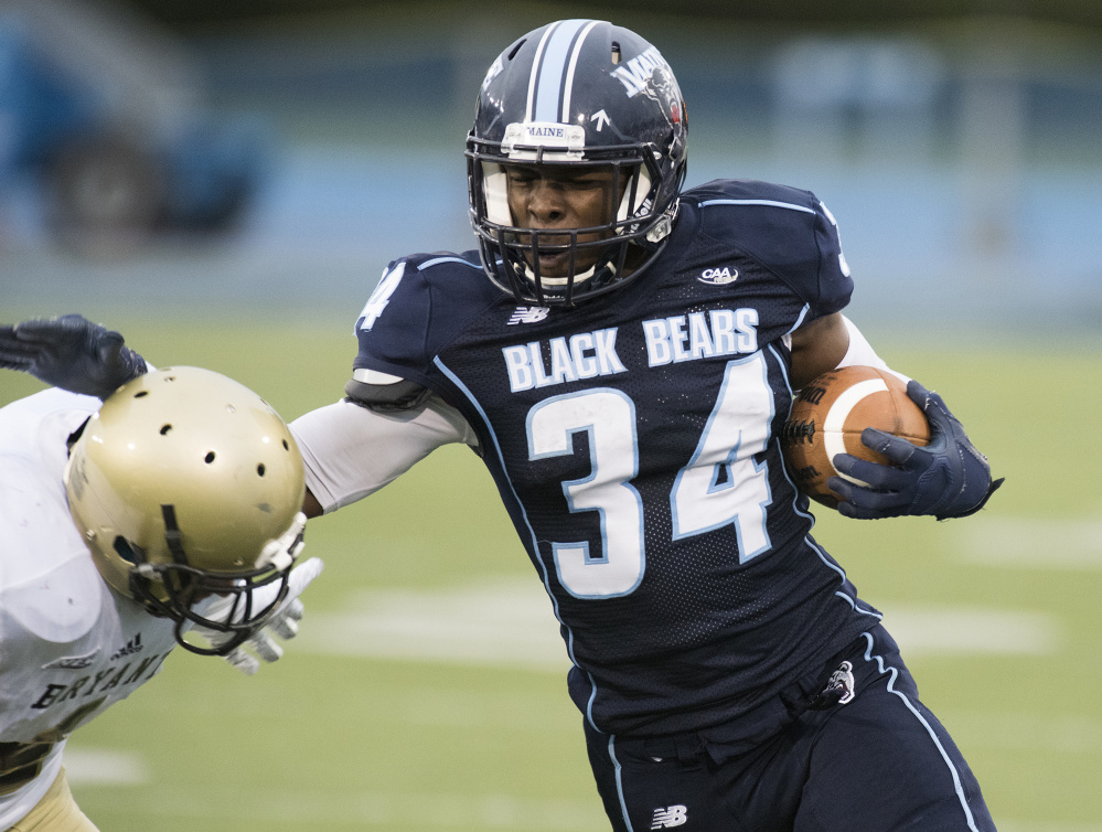 UMaine running back Josh Mack fends off a Bryant player in a game last season in Orono. Mack, now a sophomore, had a team-high 744 rushing yards and six touchdowns in 2016.