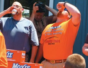 BEAU BRADSTREET, right, wins the Moxie Chugging Contest for the seventh year running on Saturday.