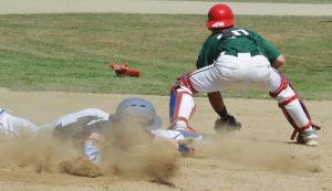 ZONE 3 UNITED base runner Zach Mann, left, slides into home as Highland Green catcher Cam Cox awaits the throw during a Senior American Legion baseball game at Freeport on Saturday. The teams split a doubleheader in Zone 3 action.
