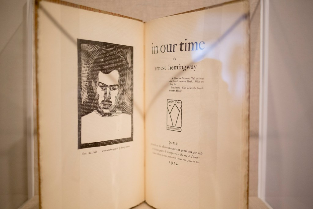 A rare book of Hemingway's that uses  a wood block print of Strater's portrait of him. The Ogunquit Museum of American Art exhibit is a series of a series of paintings, photographs, illustrated books and more that revolves around the friendship Between the two men - and it's demise.