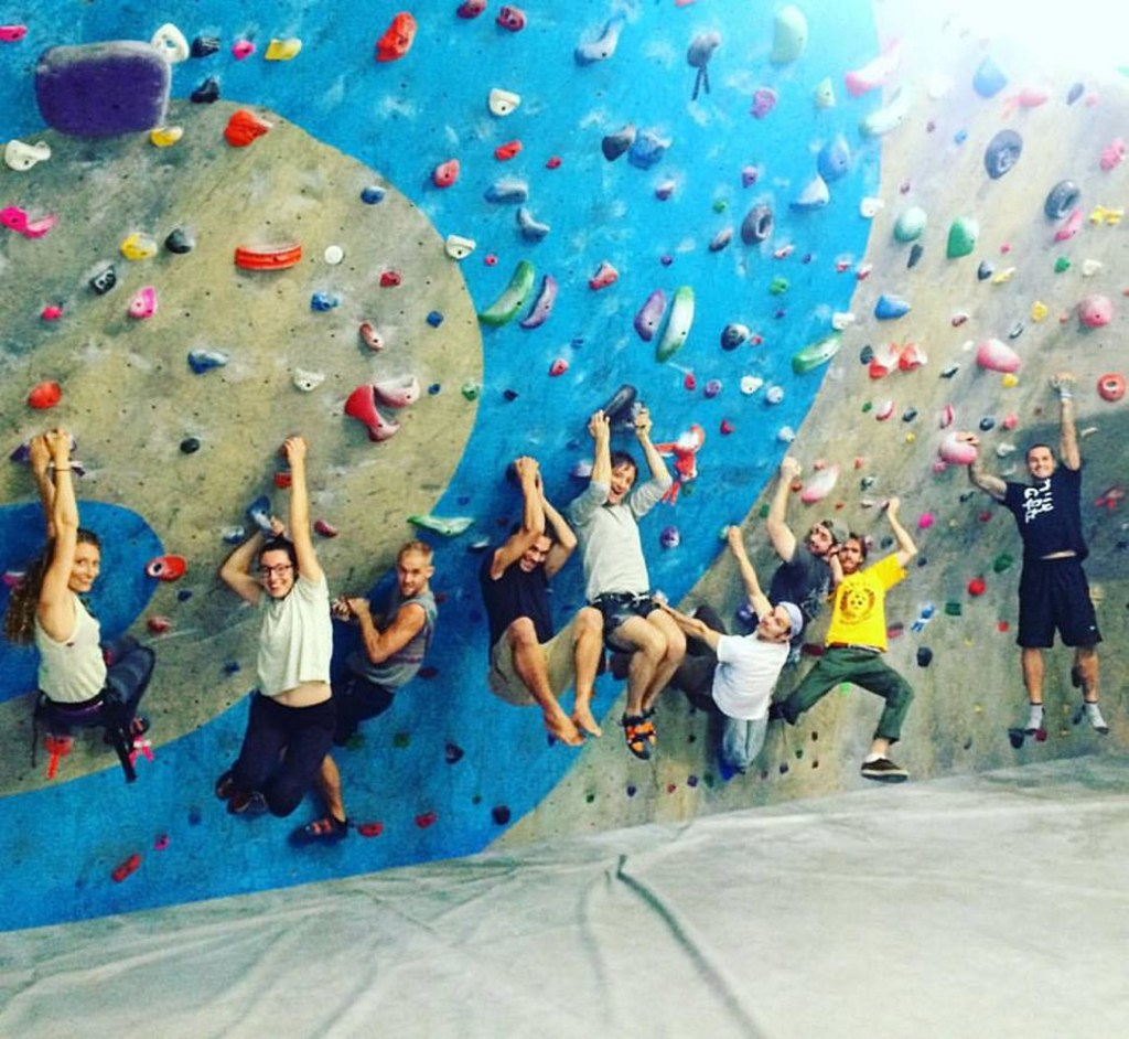 The staff of Vinland hangs out at a rock gym. On team outings colleagues can interact outside their defined roles at the Portland restaurant.