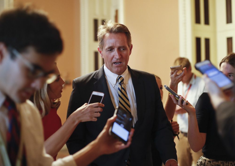 """Sen. Jeff Flake, R-Ariz., takes aim at Trump and his own party in a new book, writing that """"Unnerving silence in the face of an erratic executive branch is an abdication"""" and """"The strange specter of an American president's seeming affection for strongmen and authoritarians created such a cognitive dissonance among my generation of conservatives – who had come of age under existential threat from the Soviet Union – that it was almost impossible to believe."""""""