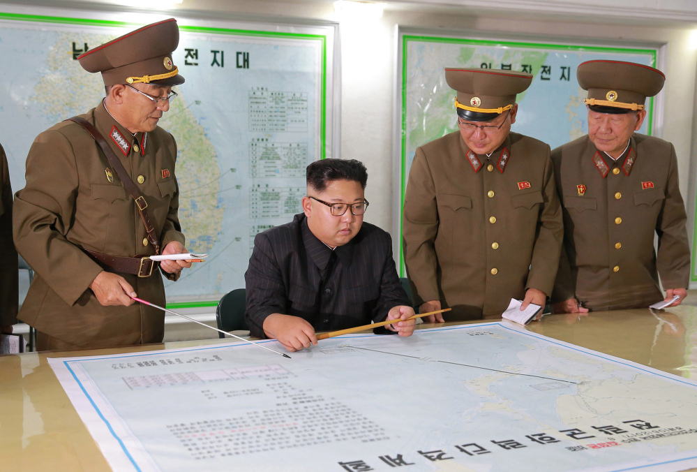 "North Korean leader Kim Jong Un, center, talks with military commanders during his visit to Korean People's Army's Strategic Forces in North Korea. The Korean Central News Agency said Tuesday that Kim, during an inspection of the KPA's Strategic Forces, praised the military for drawing up a ""close and careful"" plan."
