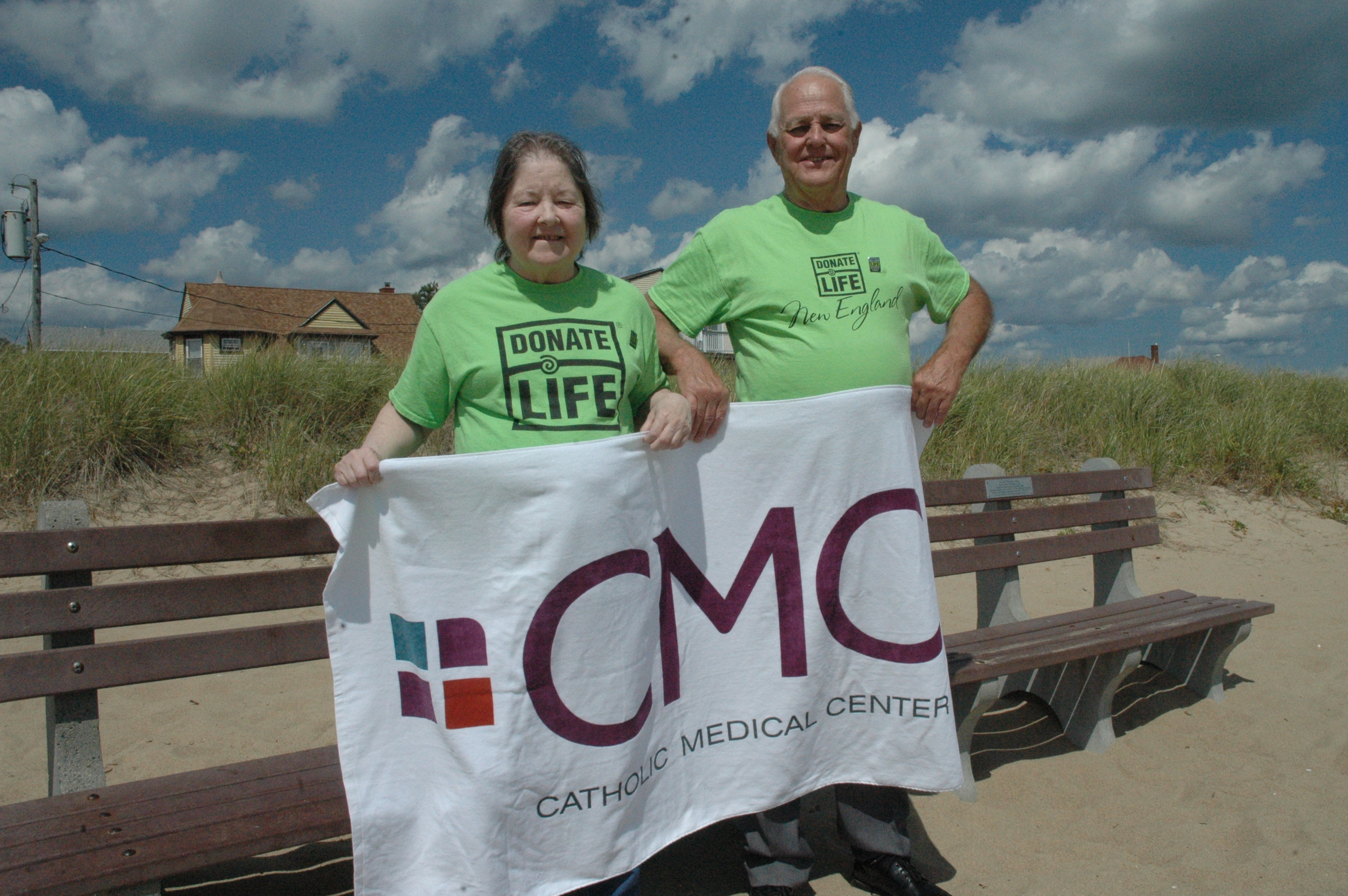 Martina and Bill Hooley stand at the beach at Old Orchard Beach on Thursday. LIZ GOTTHELF/Journal Tribune