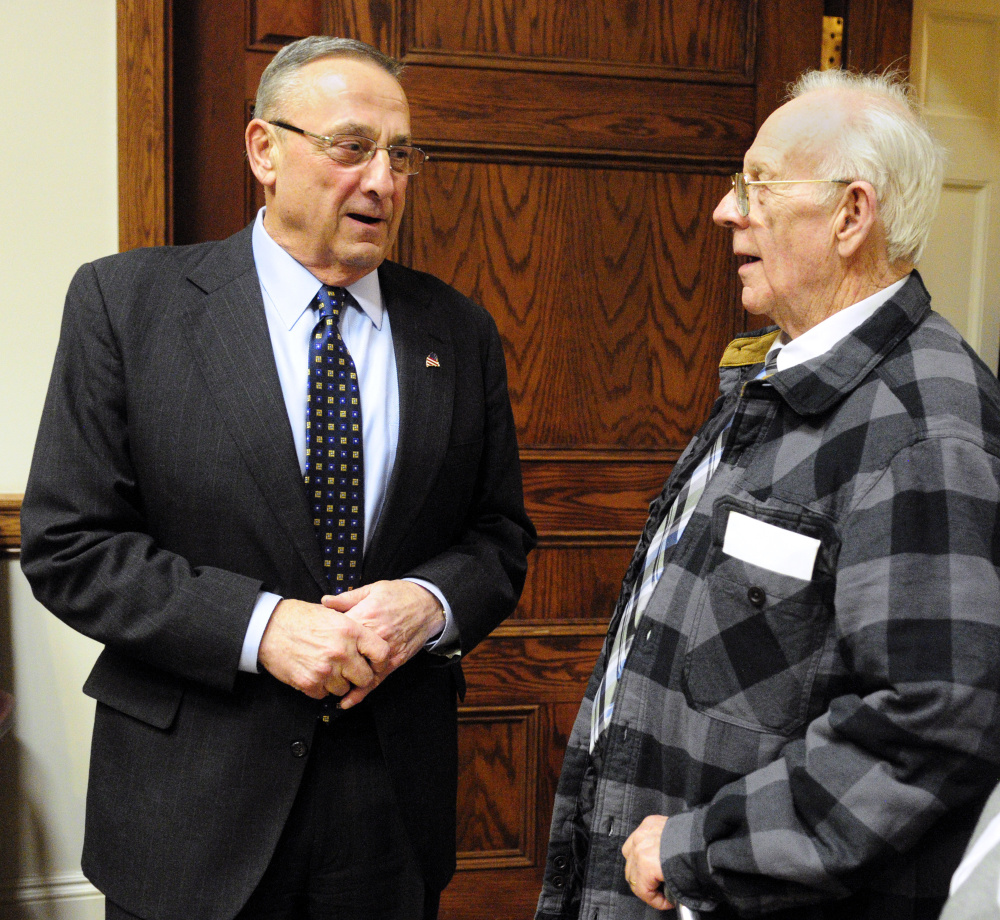 Gov. Paul LePage speaks with Richard Sukeforth on Feb. 7 before the State of the State Address. Sukeforth and his wife lost their home when the town of Albion foreclosed and auctioned it off for back taxes. LePage said in his speech that he wanted to change the law regarding those over 65 who have trouble paying property taxes.