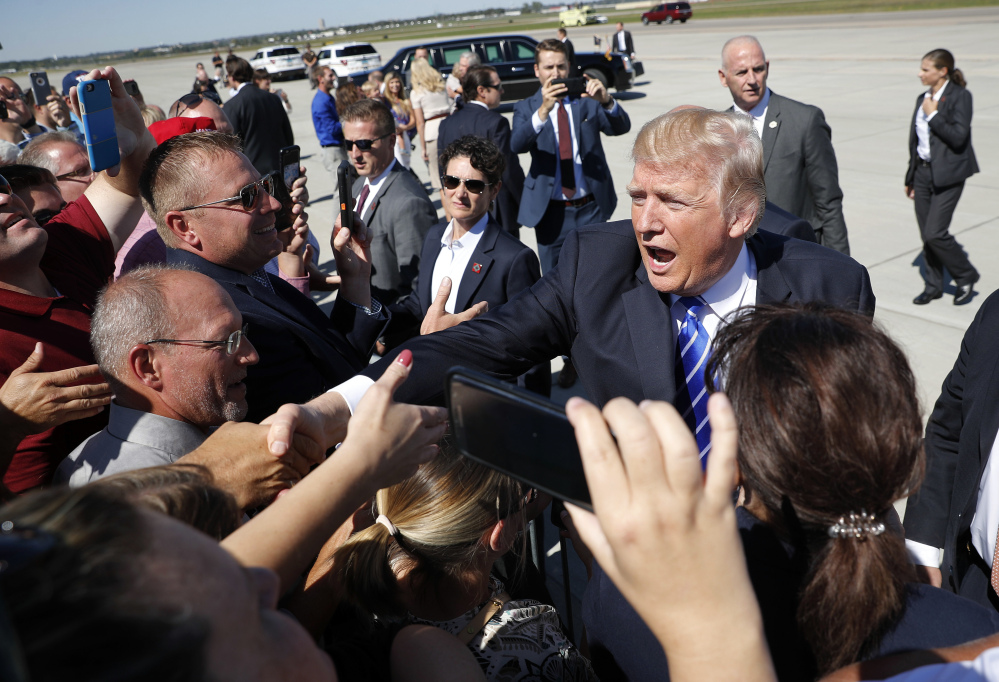President Trump greets supporters Wednesday at Bismark Municipal Airport in North Dakota, where he promoted his tax overhaul plan. Associated Press/Pablo Martinez Monsivais