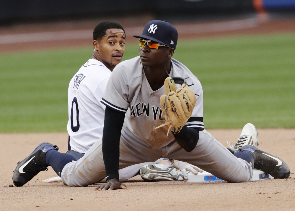 Tampa Bay's Mallex Smith, left, reacts after being forced out at second base by Yankees shortstop Didi Gregorius during the seventh inning Wednesday at the Mets' Citi Field in New York.