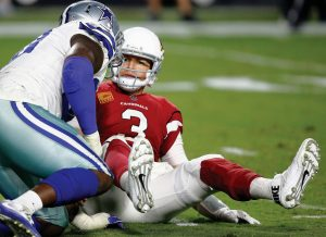 ARIZONA CARDINALS quarterback Carson Palmer (3) looks at Dallas Cowboys defensive end Demarcus Lawrence after being sacked during the second half of an NFL football game on Monday in Glendale, Ariz. The Cowboys won, 28-17.