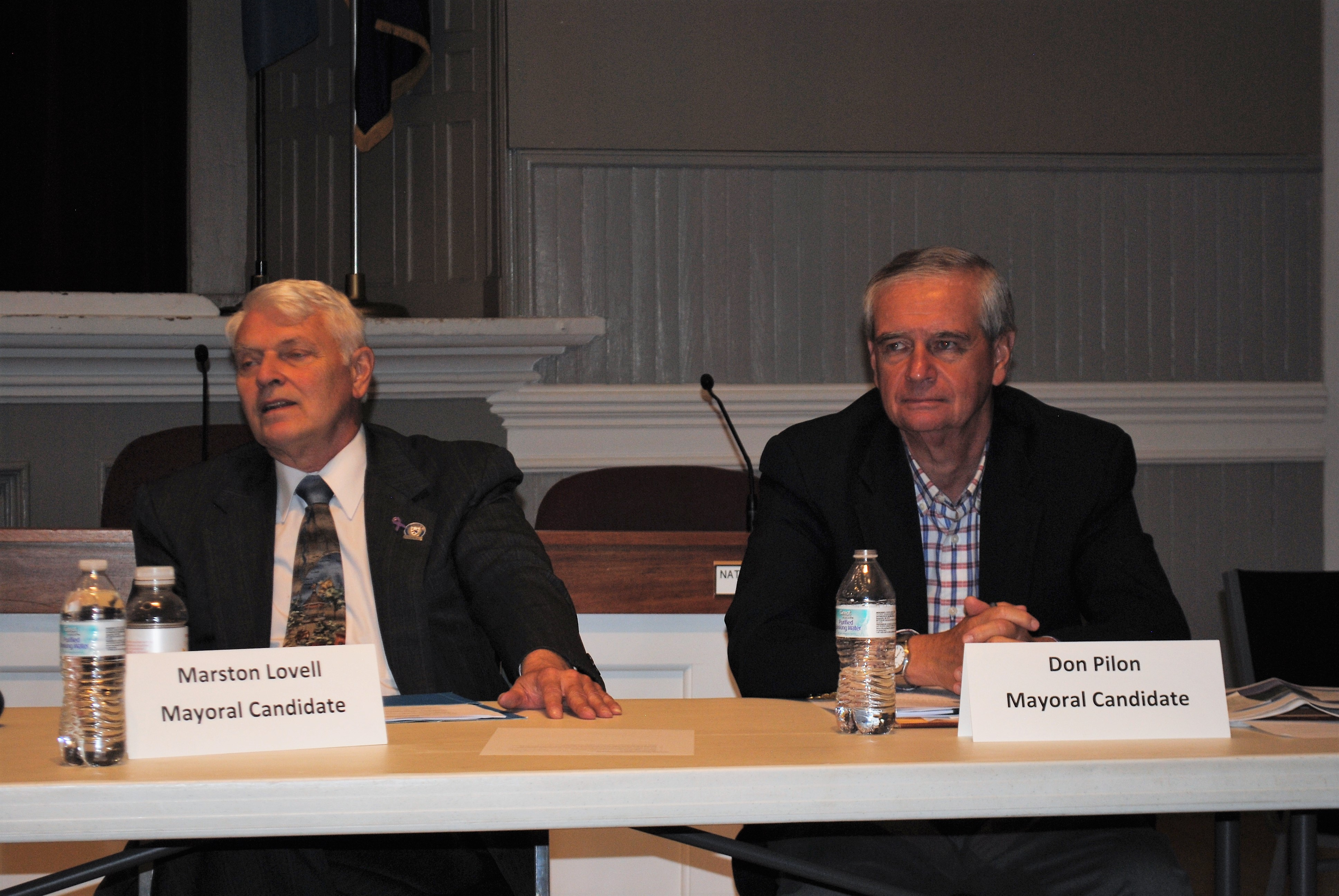 Saco mayoral candidates Marston Lovell and Don Pilon listen to a member of the public speak at a candidate forum Wednesday night at Saco City Hall hosted by Saco Main Street. LIZ GOTTHELF/Journal Tribune