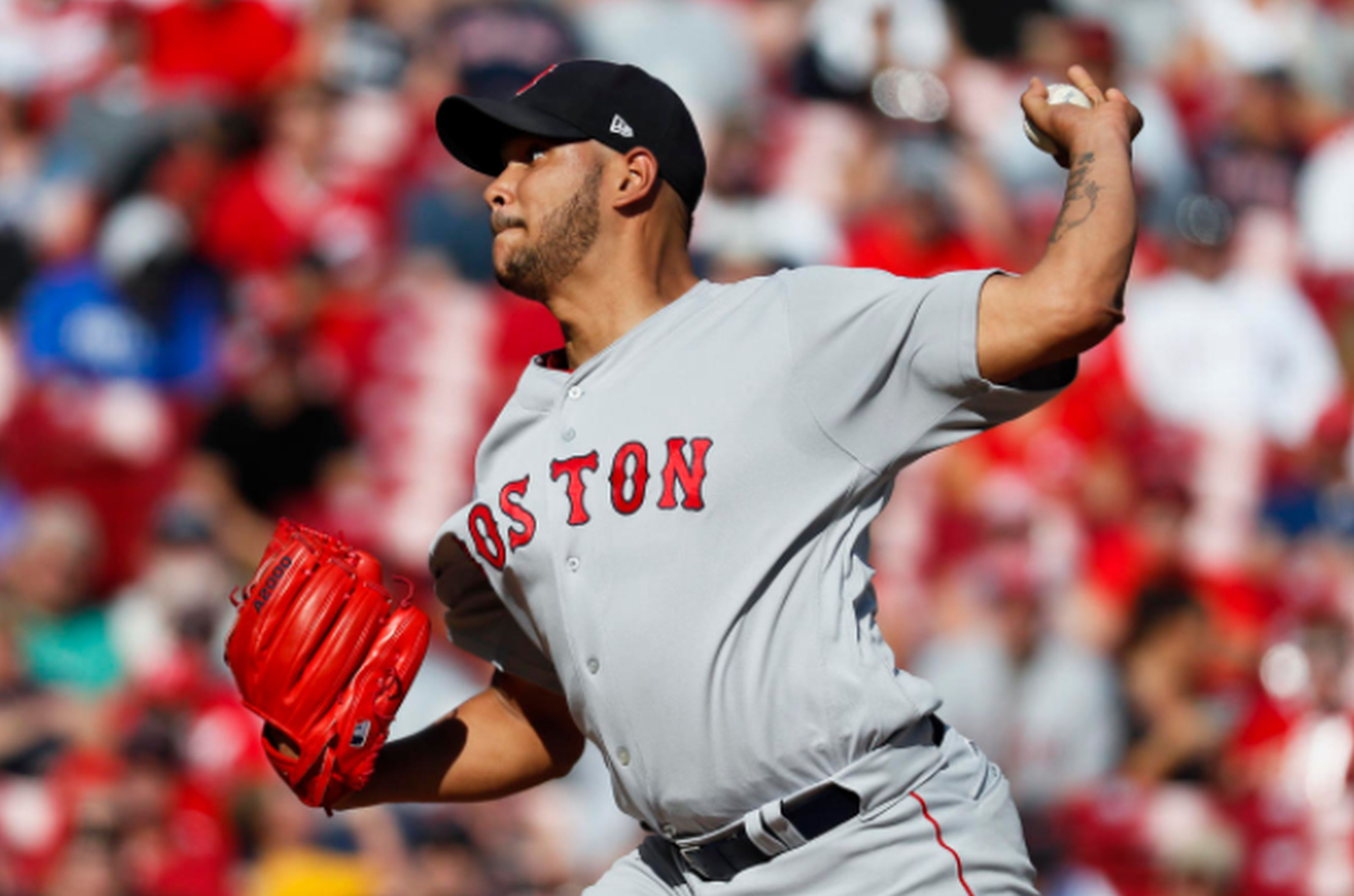 Boston Red Sox starting pitcher Eduardo Rodriguez throws in the first inning of a baseball game against the Cincinnati Reds, Saturday, Sept. 23, 2017, in Cincinnati. AP NEWSWIRE/John Minchillo