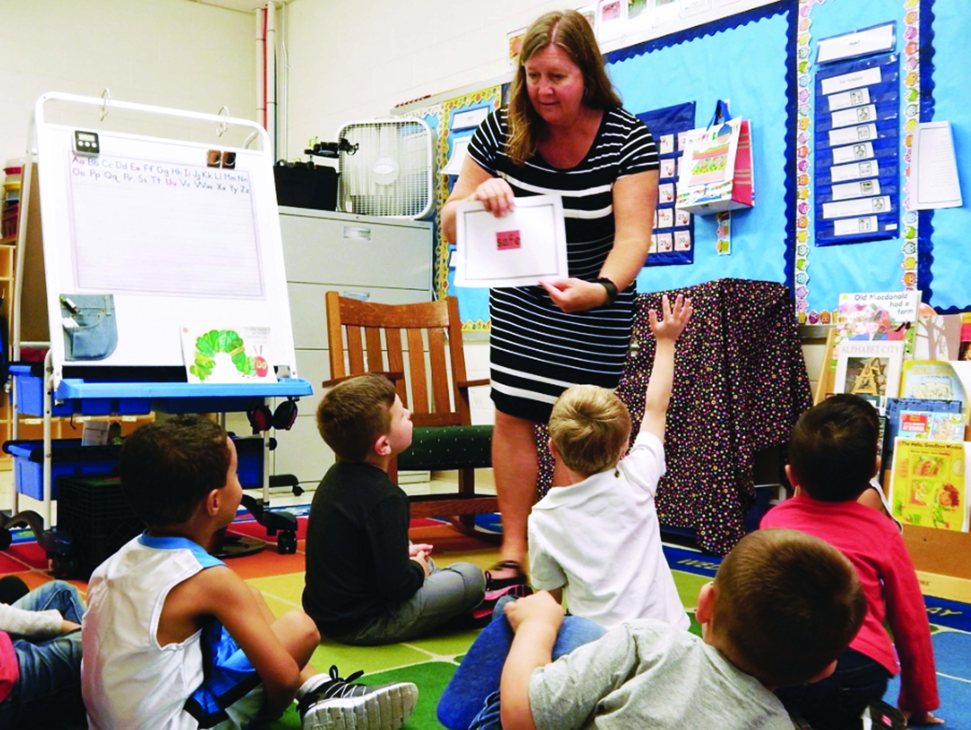 Lynanne Haley, a teacher at John  F. Kennedy Memorial School, leads a discussion with Pre-K students in a morning class in Biddeford on Wednesday. Biddeford Schools launched its first-ever Pre-K program on Monday to help students become better prepared to enter Kindergarten. ED PIERCE/Journal Tribune