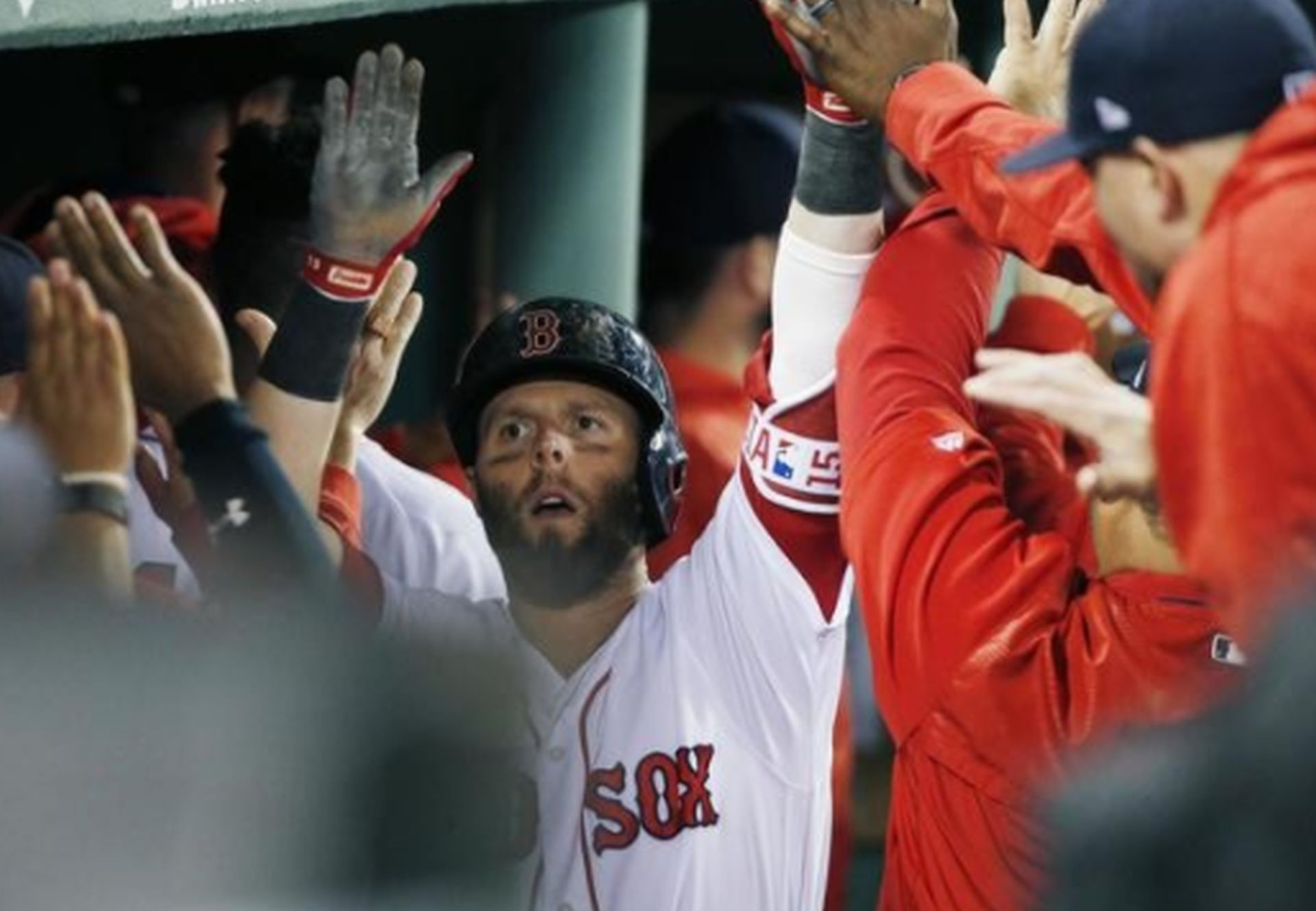 Dustin Pedroia of the Boston Red Sox celebrates his first-inning two-run home run against the Tampa Bay Rays on Saturday at Fenway Park. AP NEWSWIRE/Michael Dwyer