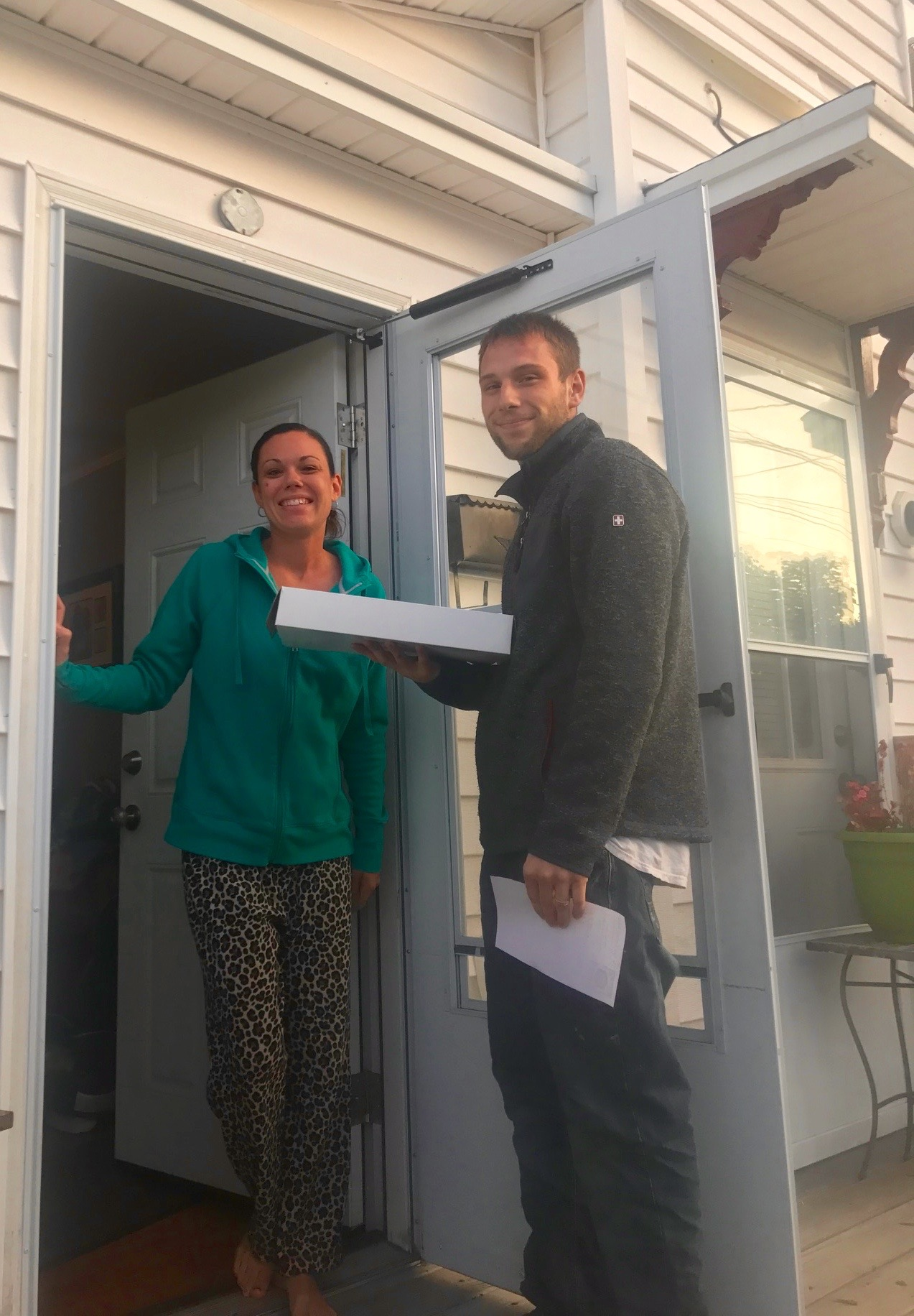 Ben Dube, owner of New England Bakery, makes his first residential donut delivery to Kim Parent on Saturday in Sanford. The bakery, which serves a number of commercial accounts, began delivery services to Sanford and Springvale residents on the Labor Day weekend. COURTESY PHOTO/New England Bakery