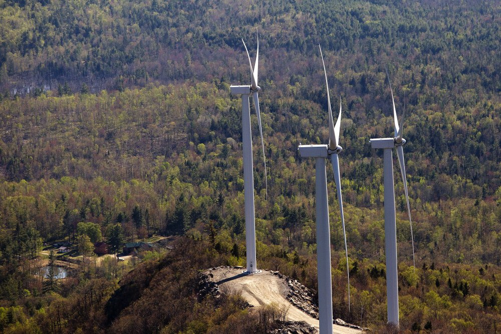 "Wind-energy turbines, like these along Saddleback Ridge in western Maine, ""would constitute a death sentence"" for the Moosehead Lake area's economy, says a letter signed by four state legislators."