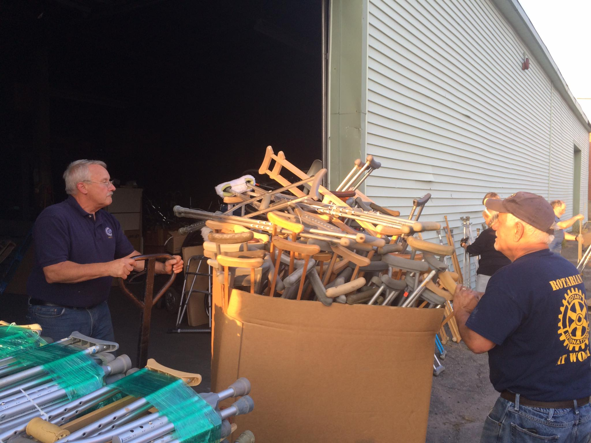 Local Rotarians move a box of crutches in a recent effort to pack up mobility aids for Crutches 4 Africa. SUBMITTED PHOTO