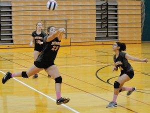 BRUNSWICK'S MACKENZIE BURROWS (23) delivers a pass with teammates Gabby Diaz, right, and Kathleen Trapp (10) looking on. The Dragons played their first varsity postseason match on Thursday, falling to Bonny Eagles in three sets. Brunswick finished 6-9.