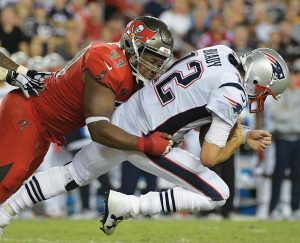 TAMPA BAY defensive tackle Gerald McCoy (93) sacks New England Patriots quarterback Tom Brady (12) during the second quarter of an NFL football game on Thursday in Tampa, Fla.