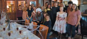 TEENS, PAUSING BRIEFLY for a photo, worked hard Saturday to prepare the Horror Hotel.