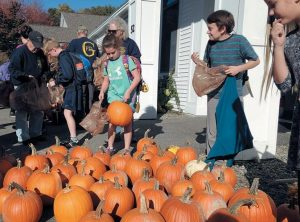 STUDENTS at Georgetown Central School choose pumpkins Friday before boarding the buses to go home.