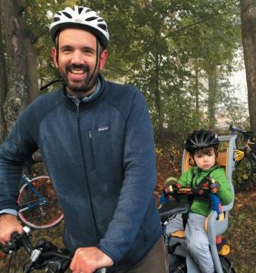 PAUL HYMAN and son, Henry, get ready to bike along the 5 mile Brunswick Landing Perimeter Trail Saturday.