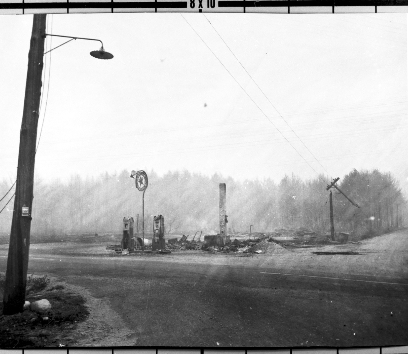 The  site of the George Hanscom store at the intersection of Route 111 and Kennebunk Pond Road after the 1947 fire swept through. COURTESY PHOTO/Brick Store Museum, Kennebunk
