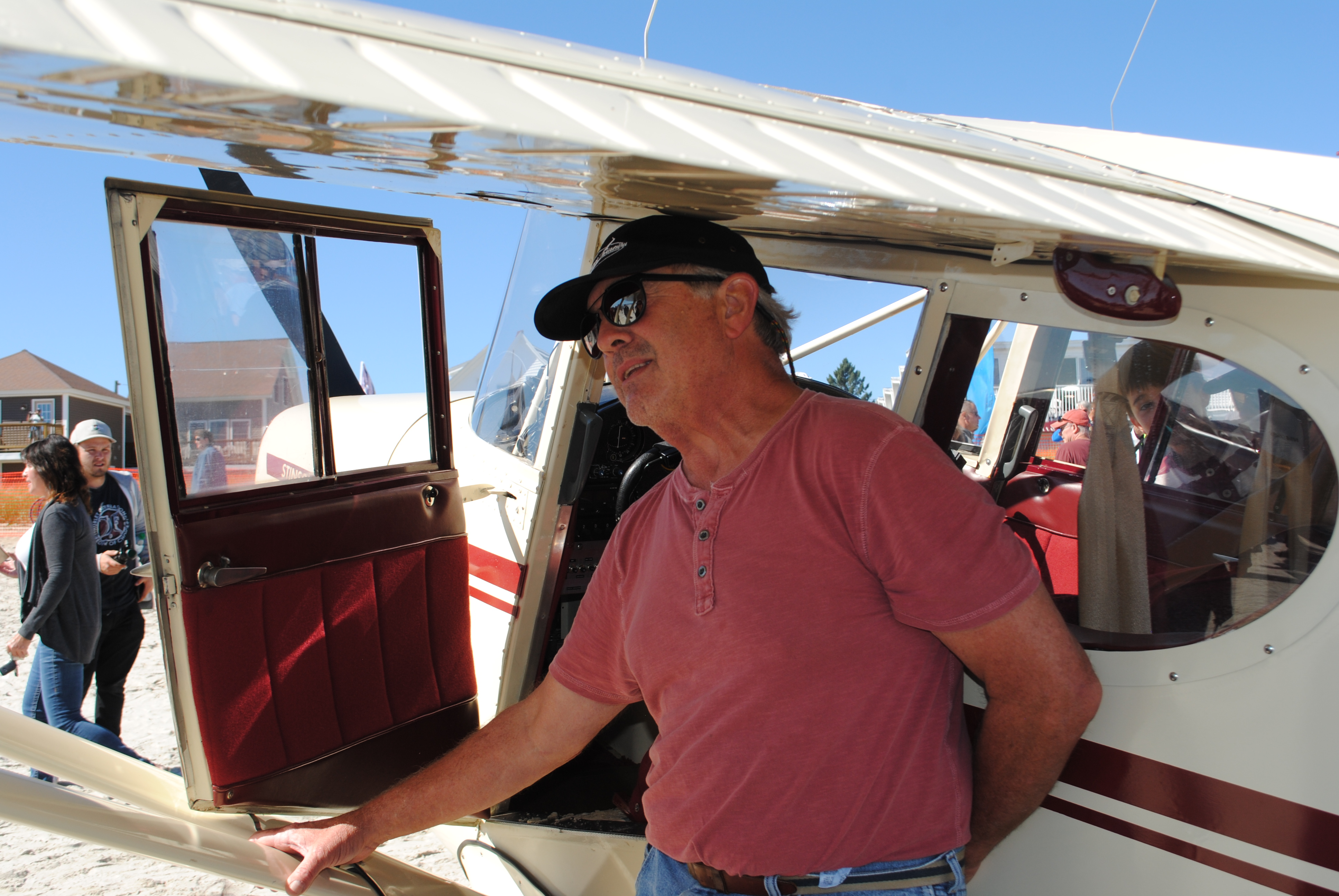 Kennebunkport pilot Karl Pepin,stands next to in his 1947 Stinson 108-1 at Wings 4 Wishes in Old Orchard Beach on Sunday. LIZ GOTTHELF/Journal Tribune