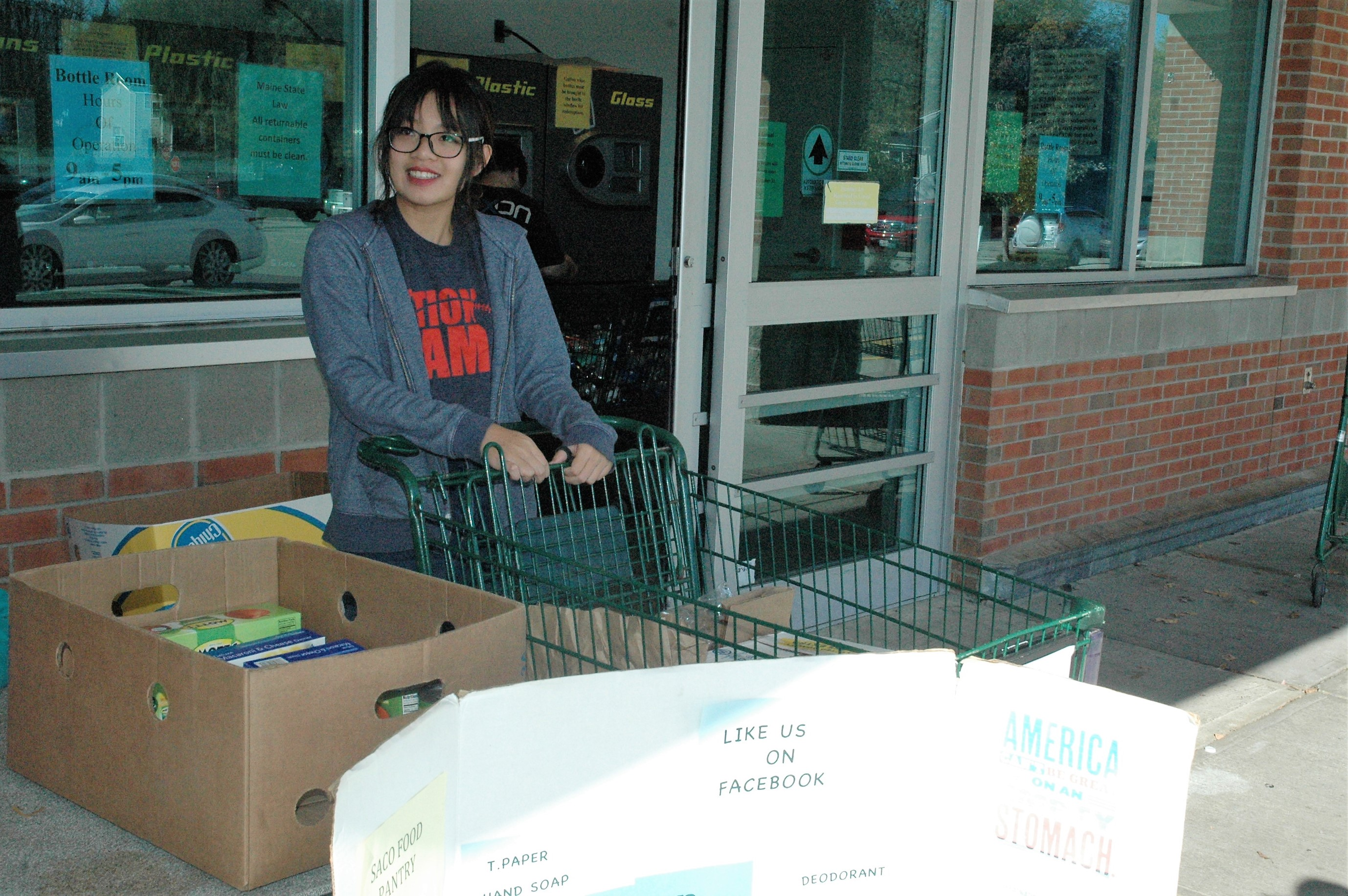LIZ GOTTHELF/Journal TribuneThornton Academy senior An Ho collects donations for the Saco Food Pantry on Saturday at Shaws in Saco.