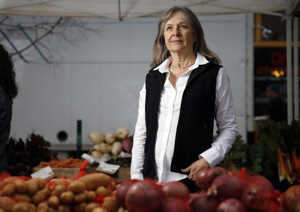 Katherine Paul of the Organic Consumers Association at the Portland Farmers Market in Monument Square on Wednesday.