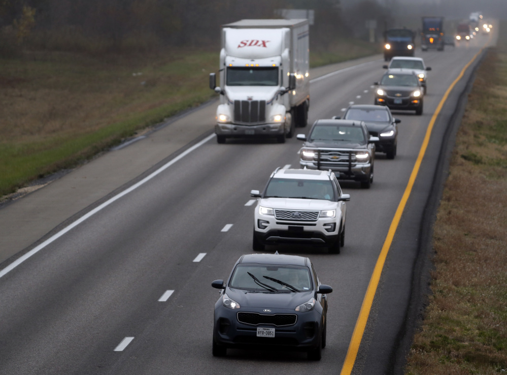 A driver holds up traffic in the passing lane along I-70 in Missouri. Many states are enacting laws against driving in the left lane except for passing or turning left.