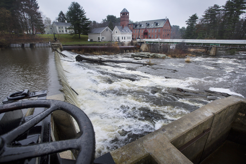 The Bridge Street Dam creates the impoundment and flatwater popular with paddlers and skaters.