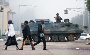 AN ARMED SOLDIER patrols a street in Harare, Zimbabwe, today. Zimbabwe's army said Wednesday it has President Robert Mugabe and his wife in custody and is securing government offices and patrolling the capital's streets following a night of unrest that included a military takeover of the state broadcaster.