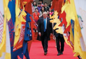 U.S. PRESIDENT DONALD TRUMP walks with South Korea's President Moon Jae-in during a welcoming ceremony at the Presidential Blue House in Seoul, South Korea, this morning. President Trump arrived in South Korea on Tuesday, beginning a two-day visit centered on pressuring the nation's neighbor to the north to abandon its nuclear weapons program.