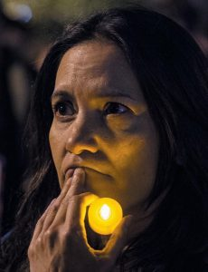 A WOMAN HOLDS A CANDLE during an interfaith vigil for peace at Foley Square in response to the Manhattan truck attack Wednesday in New York. Multiple people were killed and others seriously injured in the Tuesday attack when, authorities say, Sayfullo Saipov, a 29-year-old from Uzbekistan, barreled along the path in a pickup truck for more than a dozen blocks.