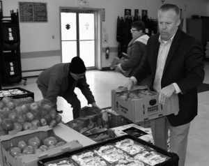 VOLUNTEERS with the Bath Area BackPack Program unpack fresh produce from the Good Shepherd Food Bank to distribute to local schools.