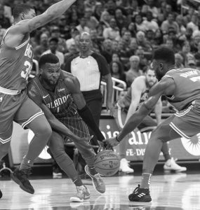 ORLANDO MAGIC guard Shelvin Mack (7) has the ball stolen by Boston Celtics guard Jaylen Brown (7) and is also guarded by guard Marcus Smart (36) during the first half of an NBA basketball game in Orlando, Fla. on Sunday. The Celtics won their eighth straight, 104-88